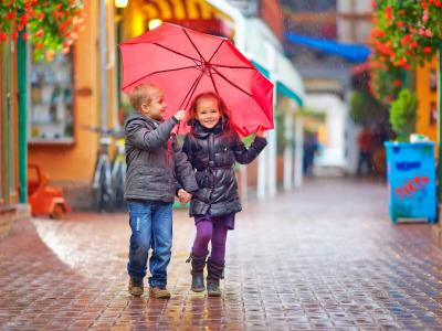 Two Kids Walking Colourful Street
