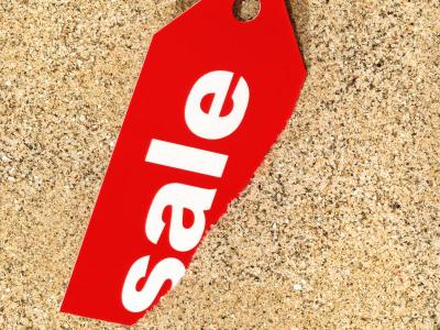 Sale tag in sand