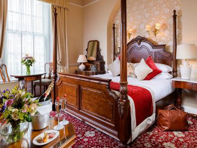 Four Poster Deluxe Guest Room