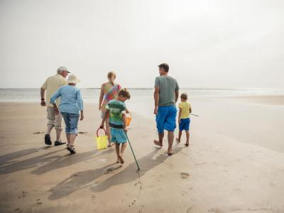 Family on beach staycation