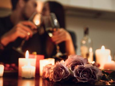 Couple with wine and flowers