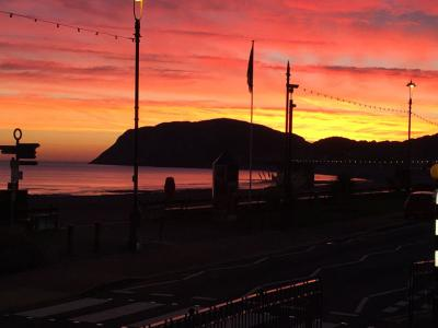 sunset over Imperial Hotel in Llandudno, Wales