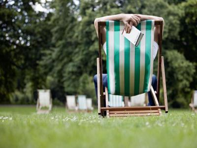 Man in deckchair in park